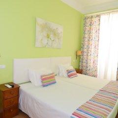 Отель Pensão Flor da Baixa комната для гостей фото 4