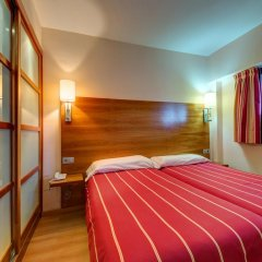 Отель Astuy Apartamentos Арнуэро комната для гостей фото 3