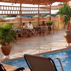 Отель Crismon Hotel Гана, Тема - отзывы, цены и фото номеров - забронировать отель Crismon Hotel онлайн питание