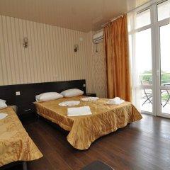 Гостиница Омега комната для гостей фото 2