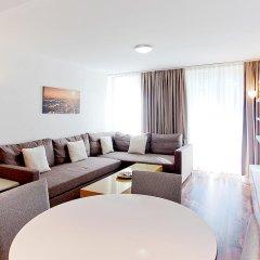 Апартаменты Premium Apartments By Livingdowntown Цюрих комната для гостей фото 3