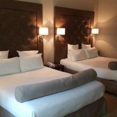 Отель Hôtel Saint Cyr Etoile 3* Улучшенный семейный номер с двуспальной кроватью фото 2