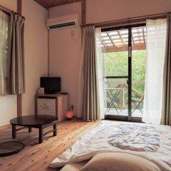 Отель Iyashi no Minshuku Tonton Якусима комната для гостей фото 5