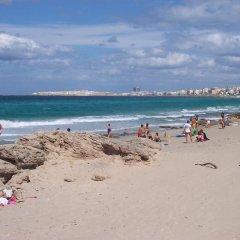 Отель Bilocali Baia Verde пляж