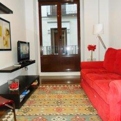 Отель Apartamentos MLR Paseo del Prado Испания, Мадрид - отзывы, цены и фото номеров - забронировать отель Apartamentos MLR Paseo del Prado онлайн комната для гостей фото 2