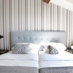 Отель Flores Guest House 4* Улучшенный номер с различными типами кроватей фото 19