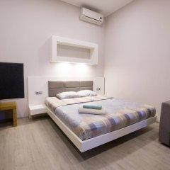 Апартаменты Pushkinskaya Apartments Харьков комната для гостей фото 5