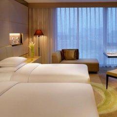 Отель Hyatt Regency Tianjin East 4* Стандартный номер с различными типами кроватей фото 4
