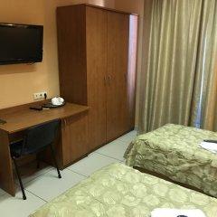 Мини-Отель Добрый Кот Кровать в общем номере фото 3