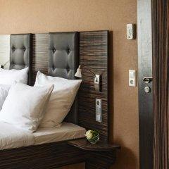 AKZENT Hotel Laupheimer Hof сейф в номере