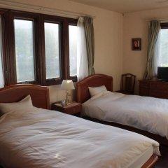 Отель La Isla Tasse Япония, Якусима - отзывы, цены и фото номеров - забронировать отель La Isla Tasse онлайн комната для гостей фото 2