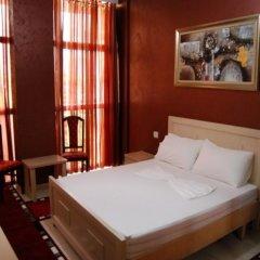 Отель Gjuta Hotel Албания, Тирана - отзывы, цены и фото номеров - забронировать отель Gjuta Hotel онлайн комната для гостей фото 3