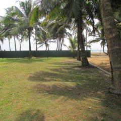 Отель Villa Whispering Shells пляж