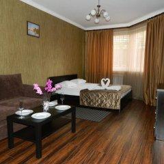 Мини-Отель Уют Стандартный семейный номер с различными типами кроватей фото 6