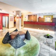 Отель Leonardo Hotel & Residenz München Германия, Мюнхен - 11 отзывов об отеле, цены и фото номеров - забронировать отель Leonardo Hotel & Residenz München онлайн интерьер отеля фото 2