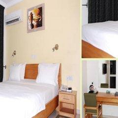 Отель Neo Courts Нигерия, Энугу - отзывы, цены и фото номеров - забронировать отель Neo Courts онлайн комната для гостей фото 3