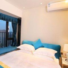 Апартаменты Guangzhou Chimelong Heefun International Service Apartment Гуанчжоу комната для гостей фото 4