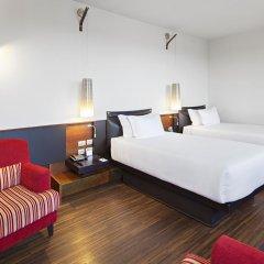 Отель NH Milano Touring 4* Улучшенный номер разные типы кроватей фото 23