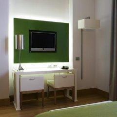 Отель NH Milano Touring 4* Стандартный номер разные типы кроватей фото 5