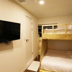 Отель STEP INN Myeongdong 1 3* Стандартный семейный номер с двухъярусной кроватью