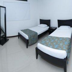 Отель Ofihotel Peñon Suites Колумбия, Кали - отзывы, цены и фото номеров - забронировать отель Ofihotel Peñon Suites онлайн комната для гостей фото 2