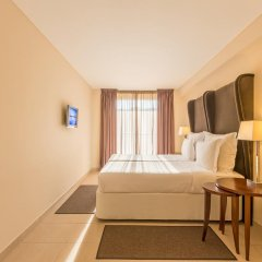 Апартаменты Salgados Palm Village Apartments & Suites - All Inclusive комната для гостей фото 4