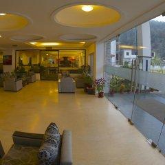 Отель Waterfront by KGH Group Непал, Покхара - отзывы, цены и фото номеров - забронировать отель Waterfront by KGH Group онлайн интерьер отеля фото 3