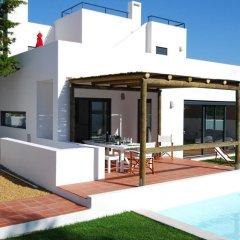 Отель Comporta Villas & Suites бассейн
