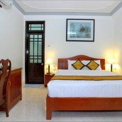 Отель Camellia Homestay 3* Стандартный номер с различными типами кроватей фото 4