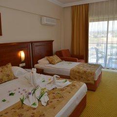 Отель Laphetos Beach Resort & Spa - All Inclusive комната для гостей фото 5