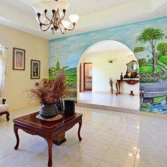 Отель Valencia Villa Ямайка, Очо-Риос - отзывы, цены и фото номеров - забронировать отель Valencia Villa онлайн интерьер отеля фото 3