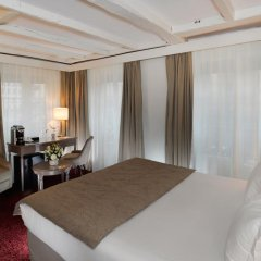 Отель Hôtel Madeleine Plaza 4* Стандартный номер с различными типами кроватей фото 5