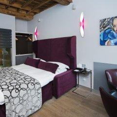 Отель Torre Argentina Relais - Residenze di Charme 3* Стандартный семейный номер с двуспальной кроватью фото 3