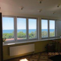 Апартаменты в Янтарном комната для гостей фото 4