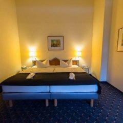 Отель 4Mex Inn Мюнхен сейф в номере
