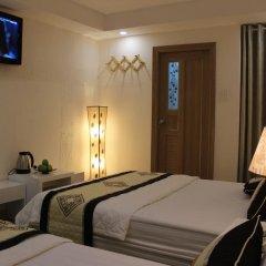 Legend Saigon Hotel Семейный номер Делюкс с двуспальной кроватью