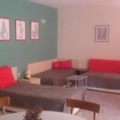 Апартаменты Comfort Apartment Поморие комната для гостей фото 2