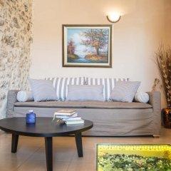 Отель Porto Enetiko Suites Улучшенные апартаменты с различными типами кроватей фото 2