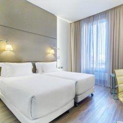 Отель NH Milano Touring 4* Улучшенный номер разные типы кроватей фото 35