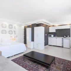Отель Defne Suites Улучшенные апартаменты с различными типами кроватей фото 7