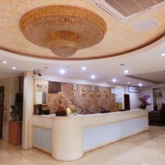 Отель Guangdong Oversea Chinese Hotel Китай, Гуанчжоу - отзывы, цены и фото номеров - забронировать отель Guangdong Oversea Chinese Hotel онлайн интерьер отеля