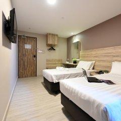 Отель Ibis Budget Singapore Crystal 2* Улучшенный номер с различными типами кроватей фото 2