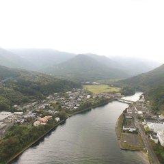 Отель Minshuku Yakusugi-sou Якусима приотельная территория фото 2