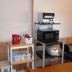 Отель Guesthouse Yakushima Якусима удобства в номере фото 2