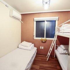 Отель Aroha Guest House 2* Кровать в общем номере с двухъярусной кроватью фото 4