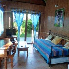 Отель Fare Manureva Бунгало с различными типами кроватей фото 4