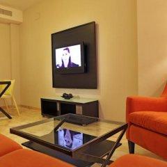 Отель Apartamentos Vértice Bib Rambla Испания, Севилья - отзывы, цены и фото номеров - забронировать отель Apartamentos Vértice Bib Rambla онлайн интерьер отеля фото 3