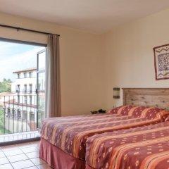 Отель PortAventura Hotel El Paso - Theme Park Tickets Included Испания, Салоу - 12 отзывов об отеле, цены и фото номеров - забронировать отель PortAventura Hotel El Paso - Theme Park Tickets Included онлайн комната для гостей фото 4