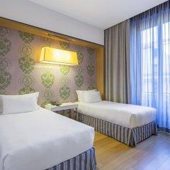 Отель NH Milano Touring 4* Стандартный номер разные типы кроватей фото 17