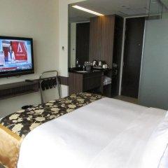 Отель Travelodge Harbourfront Singapore 4* Номер Делюкс с различными типами кроватей фото 6